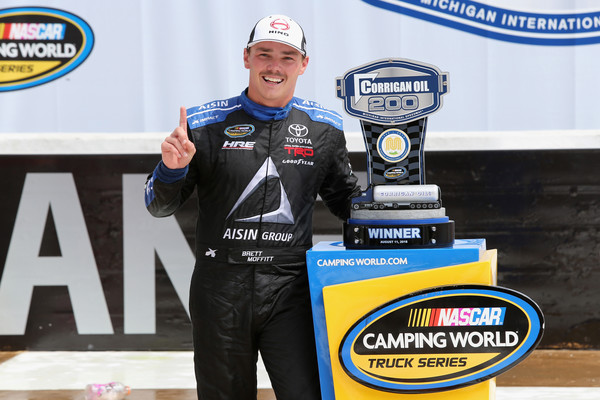 Brett Moffitt, driver of the #16 Hino Toyota, poses with the trophy in Victory Lane after winning the NASCAR Camping World Truck Series Corrigan Oil 200 at Michigan International Speedway on August 11, 2018 in Brooklyn, Michigan. Photo - Jerry Markland/Getty Images